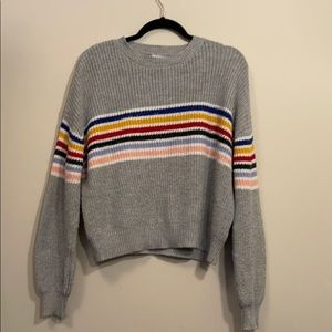 grey sweater with a pop of colour